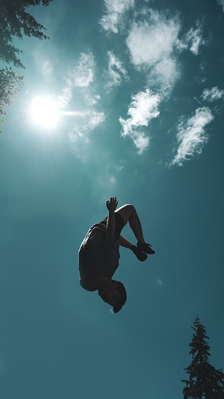 kid doin a backflip in the air