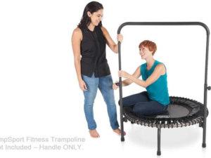 woman installing her handlebar onto her fitness trampoline