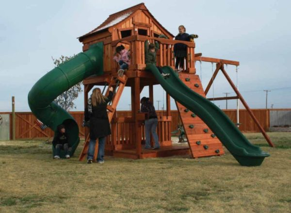 kids playing on their fort stockton playset