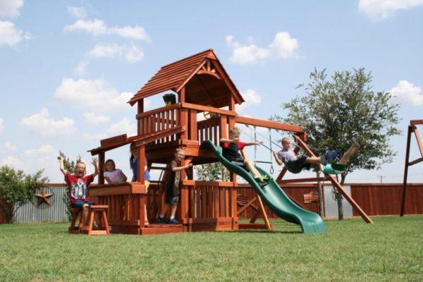 kids having fun on their fort davis playset