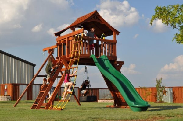 kids playing on their fort ranger playset