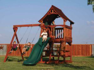 kids having fun on their redwood fun shack play set